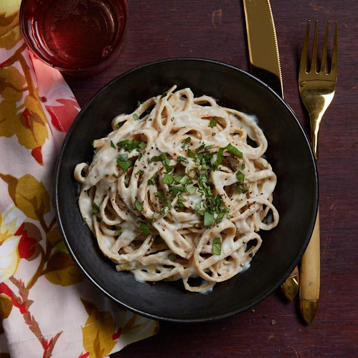 <p>Unbelievably rich and creamy, this easy vegan Alfredo is bound to become a favorite. Be sure to check the ingredient list on your unsweetened almond milk, as some contain vanilla flavoring even if they aren't labeled as such. For this recipe, you'll want almond milk without any vanilla.</p>
