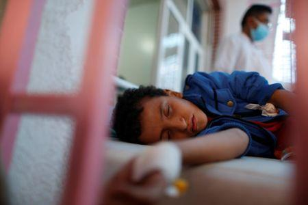 FILE PHOTO: A boy lies on a bed at a cholera treatment center in Sanaa, Yemen May 15, 2017. Picture taken May 15, 2017. REUTERS/Khaled Abdullah