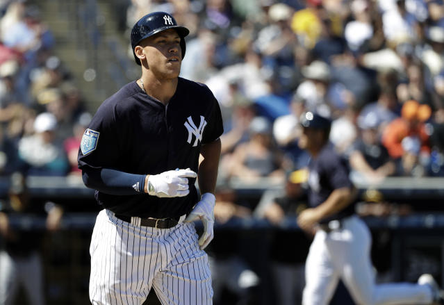 New York Yankees' Aaron Judge, left, heads for first base as Greg Bird scores on a bases loaded walk by Pittsburgh Pirates pitcher Sean Keselica during the fourth inning of a spring training baseball game Thursday, March 15, 2018, in Tampa, Fla. (AP Photo/Chris O'Meara)