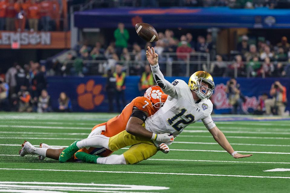 Notre Dame and quarterback Ian Book were dominated by Clemson and defensive end Austin Bryant in December. (Getty Images)