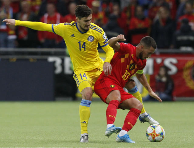 Belgium's Eden Hazard, right, and Kazakhstan's Yuri Pertsukh challenge for the ball during the Euro 2020 group I qualifying soccer match between Kazakhstan and Belgium at the Astana Arena stadium in Nur-Sultan, Kazakhstan, Sunday, Oct. 13, 2019. (AP Photo)