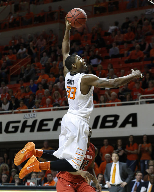 Oklahoma State guard Marcus Smart (33) goes up for a dunk in front of Texas Tech forward Jordan Tolbert (32) during the second half of an NCAA college basketball game in Stillwater, Okla., Saturday, Feb. 22, 2014. Oklahoma State won 84-62. (AP Photo/Sue Ogrocki)