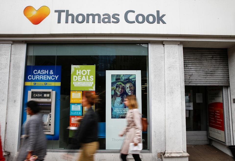 People walk past a closed Thomas Cook store in London, Britain, September 23, 2019. REUTERS/Henry Nicholls