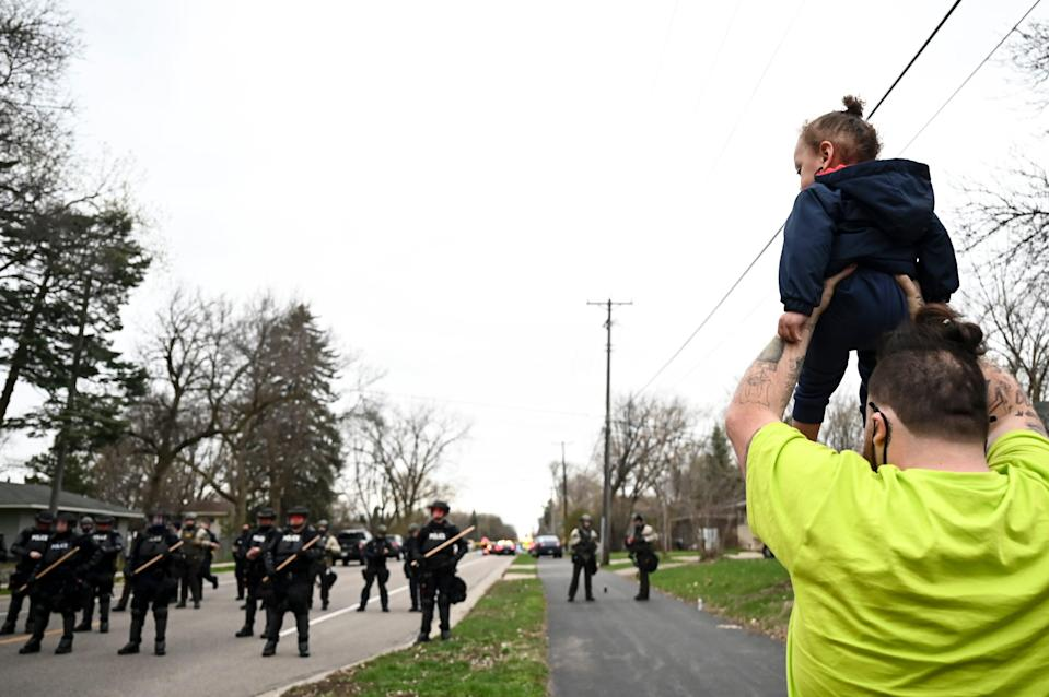 Damik Wright, brother of Daunte Wright, holds Daunte's son during Sunday protestAaron Lavinsky/Star Tribune via AP