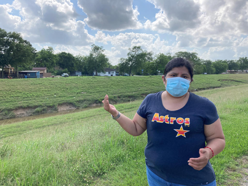 Shirley Ronquillo, a Houston area community activist, stands along Halls Bayou and discusses flood control projects that could lessen the danger the waterway presents to nearby homes during heavy rainfall on May 27, 2021, in Houston. (AP Photo/Juan A. Lozano)