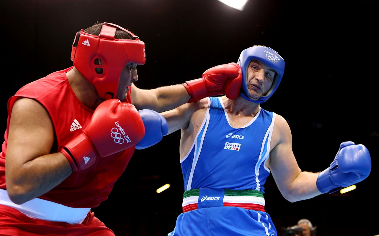LONDON, ENGLAND - AUGUST 06:  Roberto Cammarelle of Italy (R) in action with Mohammed Arjaoui of Morocco during the Men's Super Heavy ( 91kg) Boxing on Day 10 of the London 2012 Olympic Games at ExCeL on August 6, 2012 in London, England.  (Photo by Scott Heavey/Getty Images)