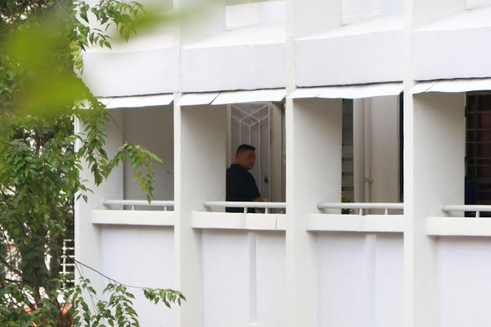 A man seen entering the Hougang flat on 5 October. (PHOTO: Dhany Osman / Yahoo News Singapore)