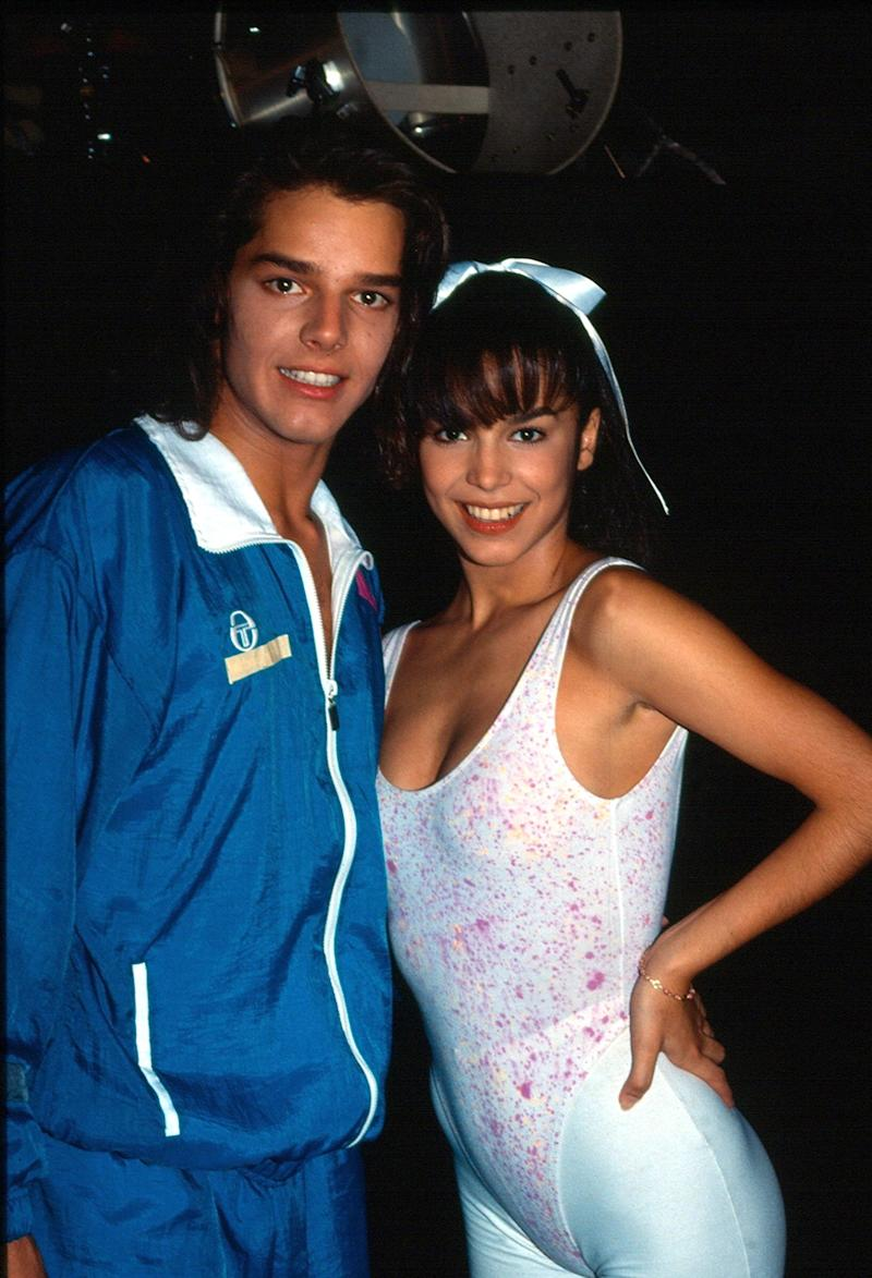 "Ricky Martin and Bibi Gaytán, as part of the ""Muñecos de Papel"" musical group."