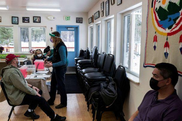 PHOTO: Nurse Practitioner Kim Sonderland speaks with tribal villagers before beginning their (COVID-19) vaccines in Eagle, Alaska, March 31, 2021. (Nathan Howard/Reuters, FILE)