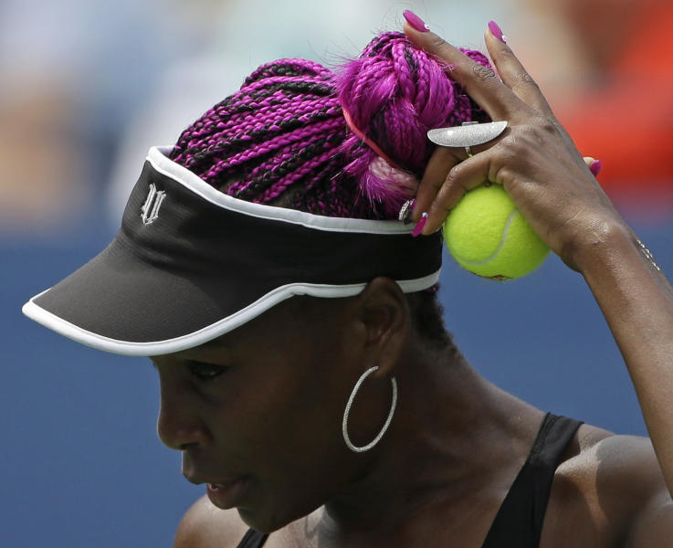 Venus Williams prepares to serve to Belgium's Kirsten Flipkens during the first round of the 2013 U.S. Open tennis tournament, Monday, Aug. 26, 2013, in New York. Williams defeated Flipkens. (AP Photo/David Goldman)
