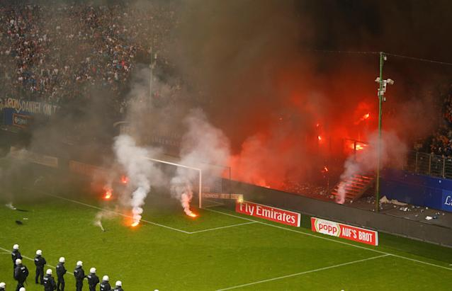 Soccer Football - Bundesliga - Hamburger SV v Borussia Moenchengladbach - Volksparkstadion, Hamburg, Germany - May 12, 2018 Hamburg fans let off flares REUTERS/Morris Mac Matzen DFL RULES TO LIMIT THE ONLINE USAGE DURING MATCH TIME TO 15 PICTURES PER GAME. IMAGE SEQUENCES TO SIMULATE VIDEO IS NOT ALLOWED AT ANY TIME. FOR FURTHER QUERIES PLEASE CONTACT DFL DIRECTLY AT + 49 69 650050