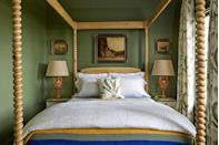 """<p>Talk about a cozy bedroom retreat! To play up this small bedroom's snug dimensions, homeowner Bailey McCarthy covered the walls and trim with a deep, rich khaki green paint color. A light wood four-poster canopy bed creates a comfy room-within-room feel and pops nicely against the dark wall color, while botanical curtains reinforce the straight-from-nature color palette and add softness. </p><p><strong>Get the Look: </strong><br>Wall Paint Color: <a href=""""https://www.benjaminmoore.com/en-us/color-overview/find-your-color/color/441/alligator-alley/"""" rel=""""nofollow noopener"""" target=""""_blank"""" data-ylk=""""slk:Alligator Alley by Benjamin Moore"""" class=""""link rapid-noclick-resp"""">Alligator Alley by Benjamin Moore</a></p>"""