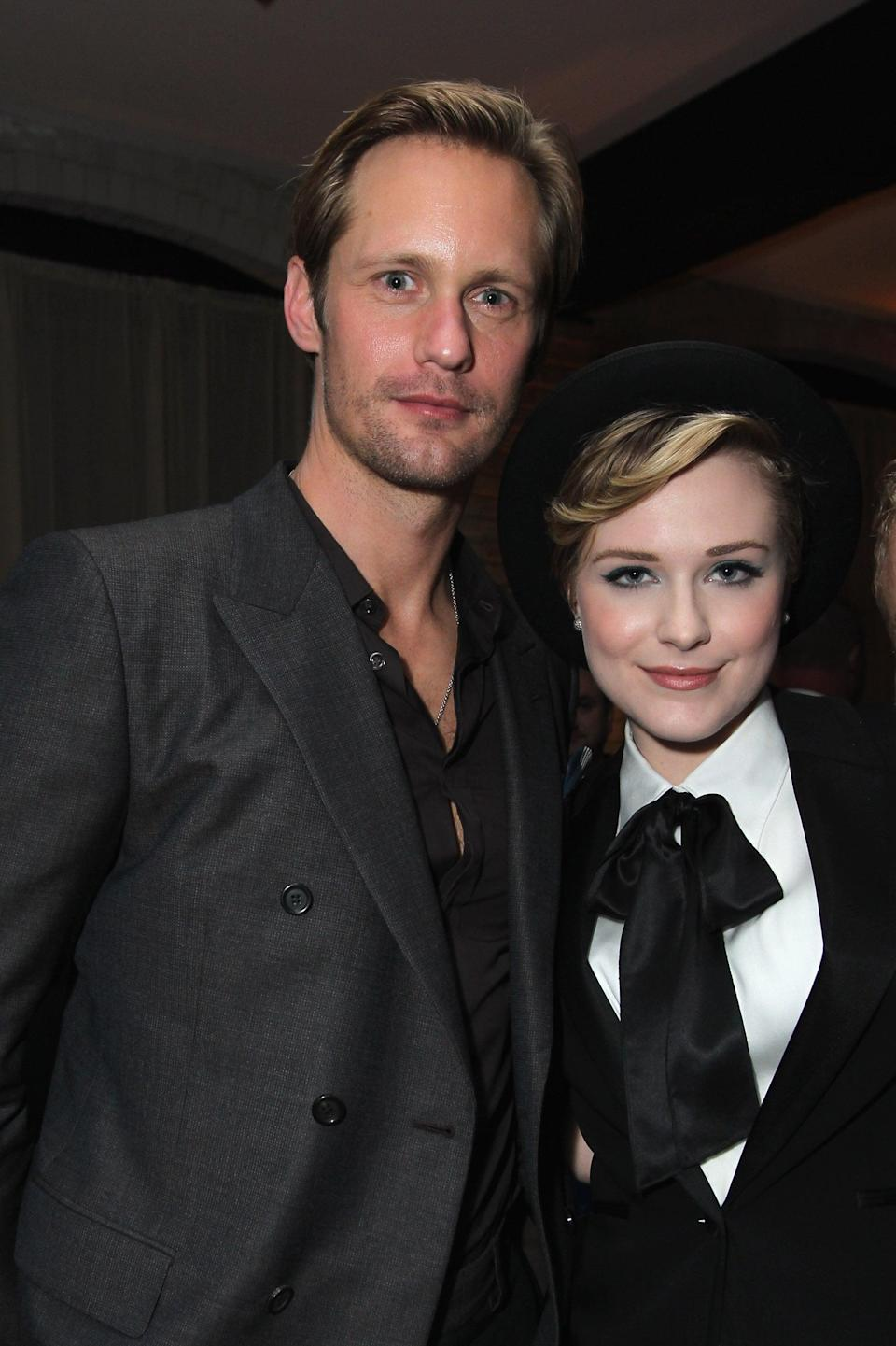 """<p>Back in 2009, rumors abounded that <strong>True Blood</strong> costars Wood and Skarsgård were romantically involved. Neither confirmed it at the time, but in 2010, Wood obliquely admitted to it in an interview with <strong>E! News</strong>.</p> <p>""""God, that [<strong>True Blood</strong>] set is just a lovefest over there,"""" she revealed. """"I've even been there myself. <a href=""""http://www.eonline.com/news/208407/evan-rachel-wood-confirms-skarsg-rd-romance-now-crushing-on-ryan-gosling#ixzz142upDo7F"""" class=""""link rapid-noclick-resp"""" rel=""""nofollow noopener"""" target=""""_blank"""" data-ylk=""""slk:I did date one of the castmembers already"""">I did date one of the castmembers already</a>."""" While not mentioning Skarsgård's name, it did certainly sound like a reference to the rumors from the previous year.<br></p>"""