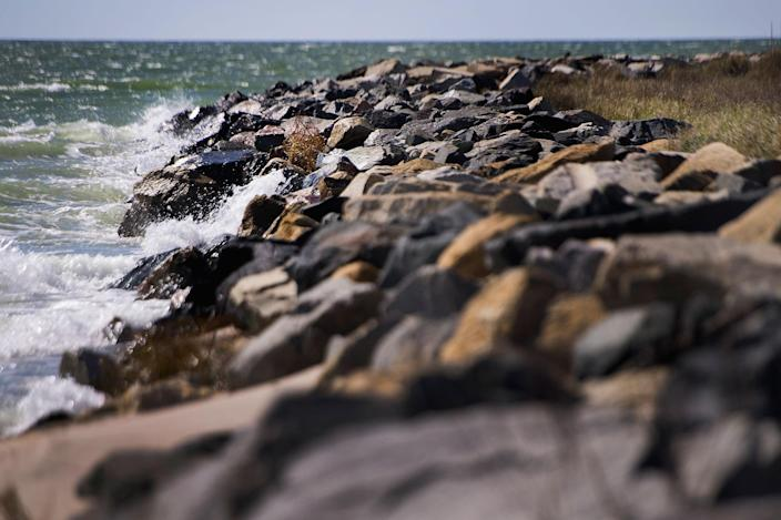 <p>The water of the Chesapeake Bay crashes against the man-made sea wall that was engineered by the Army Corps of Engineers in 1999 to prevent erosion in Tangier, Virginia, May 15, 2017, where climate change and rising sea levels threaten the inhabitants of the slowly sinking island.<br> (Jim Watson/AFP/Getty Images) </p>