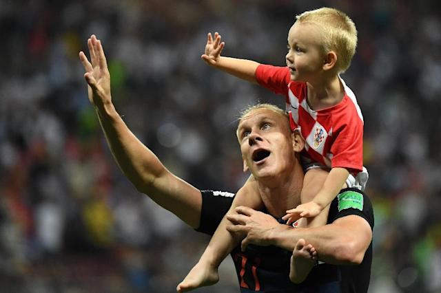 Croatia defender Domagoj Vida celebrates with his son after victory against England in the World Cup semi-finals (AFP Photo/YURI CORTEZ)