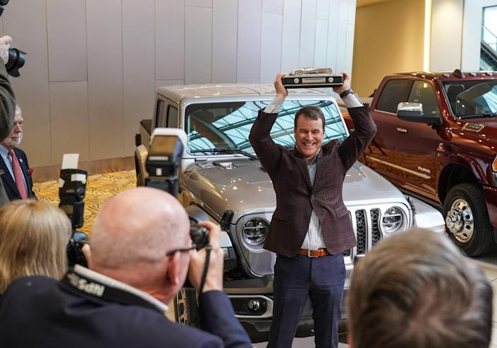 Jim Morrison Head of Jeep brand North America holds his award up for photographers after accepting the award for the 2020 North American Truck of the Year for the 2020 Jeep Gladiator at the TCF Center in Detroit on Monday, January 13, 2020.