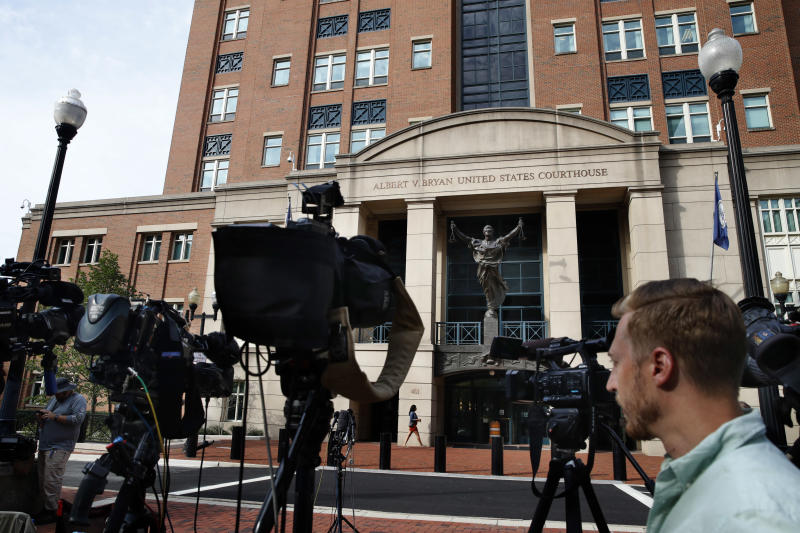 Television cameras are set up outside of federal court as jury deliberations are set to begin in the trial of former Trump campaign chairman Paul Manafort in Alexandria Va. Thursday Aug. 16 2018
