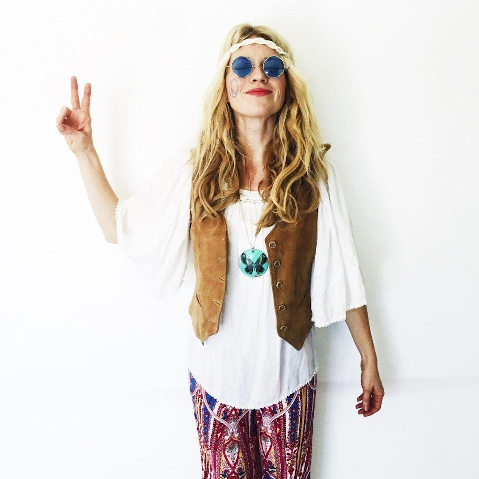 "<p>Put a vest on it! As evidenced here and in previous slides, adding a vest to a flowy ensemble is pretty much the key to a DIY hippie look. Round sunglasses and long, center-parted hairstyle drive it home. </p><p><strong>Get the tutorial at <a href=""http://thegirlswithglasses.com/videos-5-super-easy-halloween-costumeshttpthegirlswithglasses-comwp-contentuploads201510img_5081-1024x1024-jpg/"" rel=""nofollow noopener"" target=""_blank"" data-ylk=""slk:The Girls With Glasses"" class=""link rapid-noclick-resp"">The Girls With Glasses</a>. </strong> </p><p><strong><a class=""link rapid-noclick-resp"" href=""https://www.amazon.com/Hotouch-Open-Front-Sleeveless-Tassels-Cardigan/dp/B07C7DS2KM/ref=sr_1_1_sspa?tag=syn-yahoo-20&ascsubtag=%5Bartid%7C10050.g.28305469%5Bsrc%7Cyahoo-us"" rel=""nofollow noopener"" target=""_blank"" data-ylk=""slk:SHOP FRINGE VESTS"">SHOP FRINGE VESTS</a><br></strong></p>"