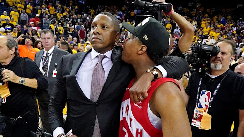 Ujiri, left, and Lowry share an embrace on the court. (Mandatory Credit: Kyle Terada-USA TODAY Sports)