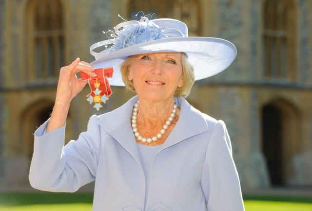 Mary Berry after she became a Commander of the British Empire by the Prince of Wales