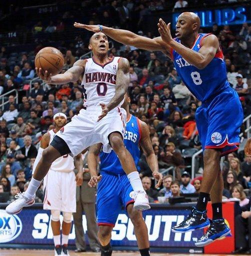 Atlanta Hawks guard Jeff Teague (0) drives to the basket to score against Philadelphia 76ers guard Damien Wilkins during the first half of their NBA basketball game on Wednesday, March 6, 2013, in Atlanta. (AP Photo/Atlanta Journal-Constitution, Curtis Compton)