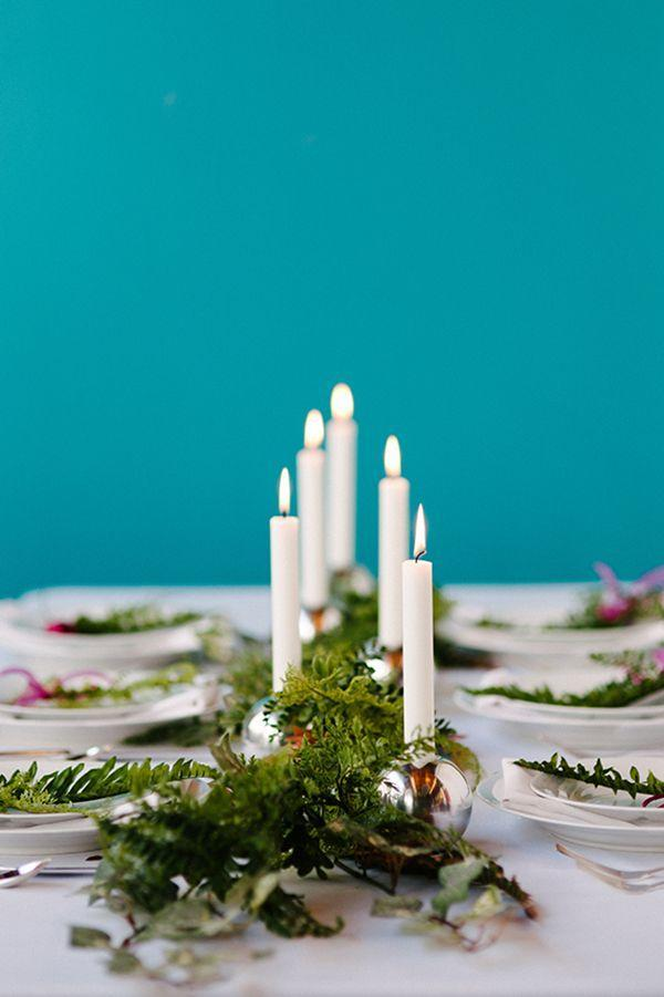 """<p>You know what silver bells mean—it's Christmas time! Dress up your table in holiday style with shiny candlestick holders that resemble baubles and bells.</p><p><strong>Get the tutorial at <a href=""""https://apracticalwedding.com/non-floral-garland-centerpieces/"""" rel=""""nofollow noopener"""" target=""""_blank"""" data-ylk=""""slk:A Practical Wedding"""" class=""""link rapid-noclick-resp"""">A Practical Wedding</a>.</strong></p><p><strong><a class=""""link rapid-noclick-resp"""" href=""""https://www.amazon.com/Krylon-K09196000-COVERMAXX-Metallic-Silver/dp/B013LT6JS8/?tag=syn-yahoo-20&ascsubtag=%5Bartid%7C10050.g.644%5Bsrc%7Cyahoo-us"""" rel=""""nofollow noopener"""" target=""""_blank"""" data-ylk=""""slk:SHOP SILVER SPRAY PAINT"""">SHOP SILVER SPRAY PAINT</a><br></strong></p>"""