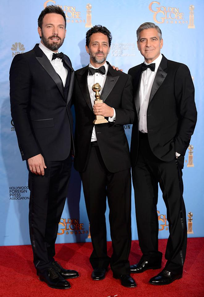Ben Affleck, Grant Heslov and George Clooney in the press room at the 70th Annual Golden Globe Awards in Beverly Hills, CA on January 13, 2013.