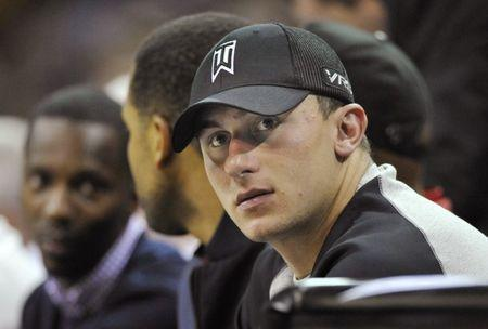 Cleveland Browns quarterback Johnny Manziel watches the Dallas Mavericks at Cleveland Cavaliers NBA game at Quicken Loans Arena, in Cleveland, Ohio, U.S., October 17, 2014. REUTERS/David Richard-USA TODAY Sports/File photo