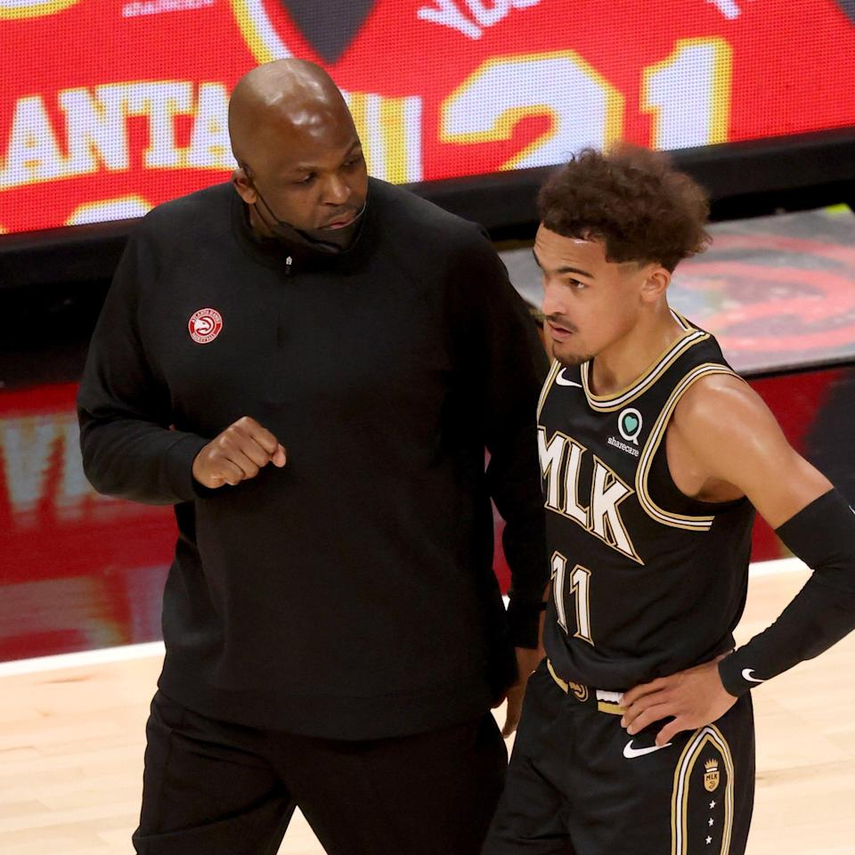 Trae Young (11) has improved his efficiency under interim coach Nate McMillan.