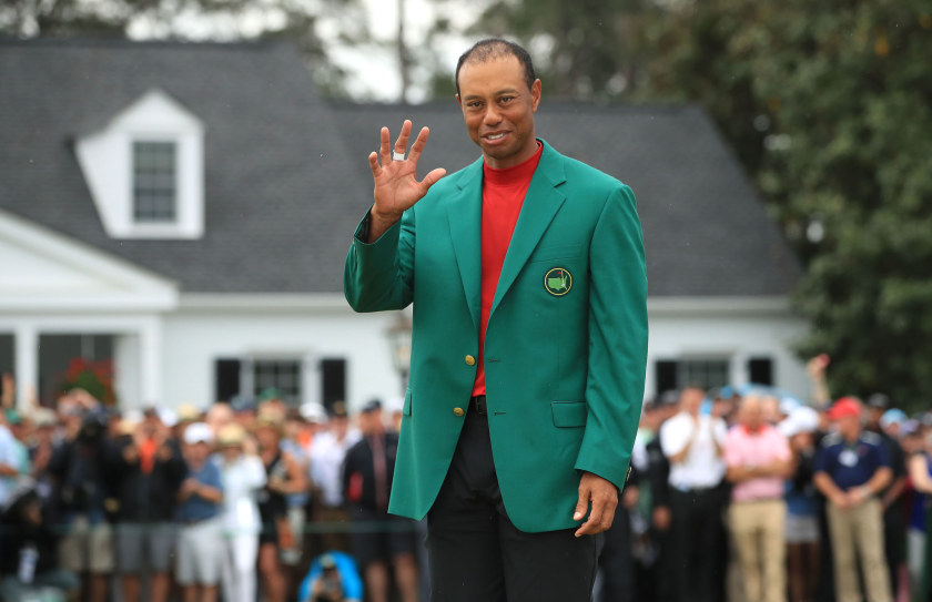 Tiger Woods wears the green jacket after winning the 2019 Masters at Augusta National.