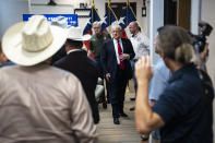 Former President Donald J. Trump and Texas Governor Greg Abbott depart after a security briefing with state officials and law enforcement at the Weslaco Department of Public Safety DPS Headquarters before touring the US-Mexico border wall on Wednesday, June 30, 2021 in Weslaco, Texas. (Jabin Botsford/The Washington Post via AP, Pool)