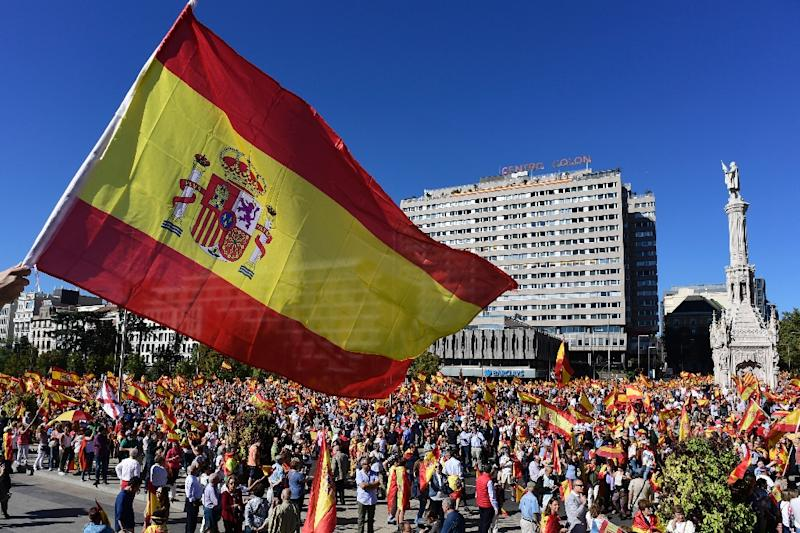 "In a fluttering sea of flags, tens of thousands of protesters in central Madrid banged drums and yelled ""Viva Espana!"" and ""National unity!"" (AFP Photo/JAVIER SORIANO)"