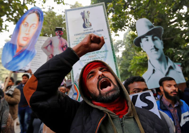 A demonstrator shouts slogans during a protest against a new citizenship law, in New Delhi