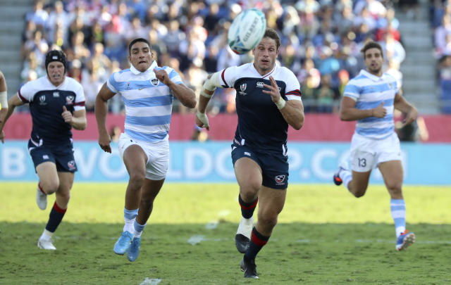 United States' Blaine Scully, right, and Argentina's Santiago Carreras chase the ball during the Rugby World Cup Pool C game at Kumagaya Rugby Stadium between Argentina and the United States in Kumagaya City, Japan, Wednesday, Oct. 9, 2019. (AP Photo/Eugene Hoshiko)