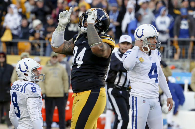 Pittsburgh Steelers defensive end Tyson Alualu (94) celebrates as a field goal-attempt by Indianapolis Colts kicker Adam Vinatieri (4) goes wide from the hold of Rigoberto Sanchez (8) during the second half an NFL football game, Sunday, Nov. 3, 2019, in Pittsburgh. (AP Photo/Gene J. Puskar)