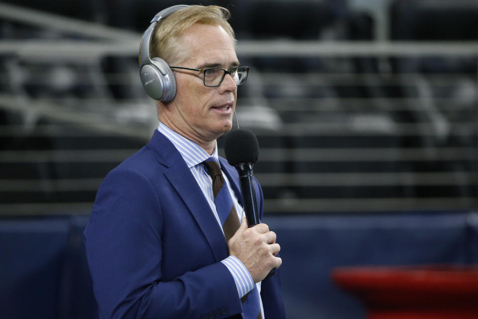 Joe Buck with a microphone and headset.