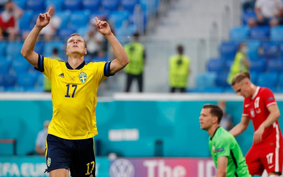 Viktor Claesson celebrates after making it 3-2 to Sweden at the death - GETTY IMAGES