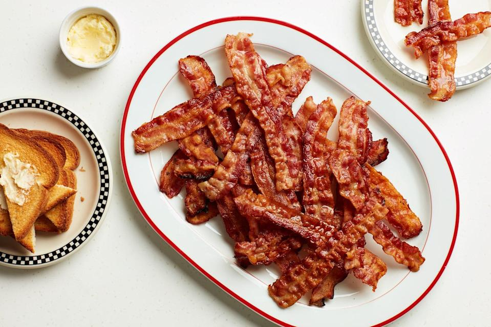 """When you need to cook <a href=""""https://www.epicurious.com/expert-advice/cook-bacon-fast-for-a-crowd-diner-trick-article?mbid=synd_yahoo_rss"""" rel=""""nofollow noopener"""" target=""""_blank"""" data-ylk=""""slk:40 strips of bacon at a time"""" class=""""link rapid-noclick-resp"""">40 strips of bacon at a time</a>, this is the best way to do it. <a href=""""https://www.epicurious.com/recipes/food/views/diner-style-bacon-for-a-crowd?mbid=synd_yahoo_rss"""" rel=""""nofollow noopener"""" target=""""_blank"""" data-ylk=""""slk:See recipe."""" class=""""link rapid-noclick-resp"""">See recipe.</a>"""