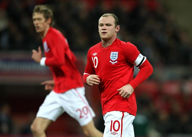 <p>England's Wayne Rooney wears the captain's armband in 2010 </p>