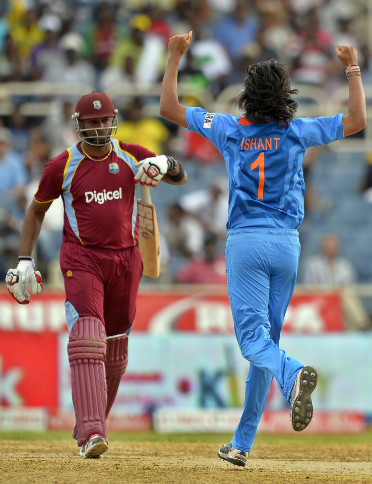 Indian cricketer Ishant Sharma (R) celebrates dismissing West indies captain Kieron Pollard during the second match of the Tri-Nation series between Indian and West Indies at the Sabina Park stadium in Kingston on June 30, 2013. India have scored 229/7 at the end of their innings. AFP PHOTO/Jewel Samad        (Photo credit should read JEWEL SAMAD/AFP/Getty Images)