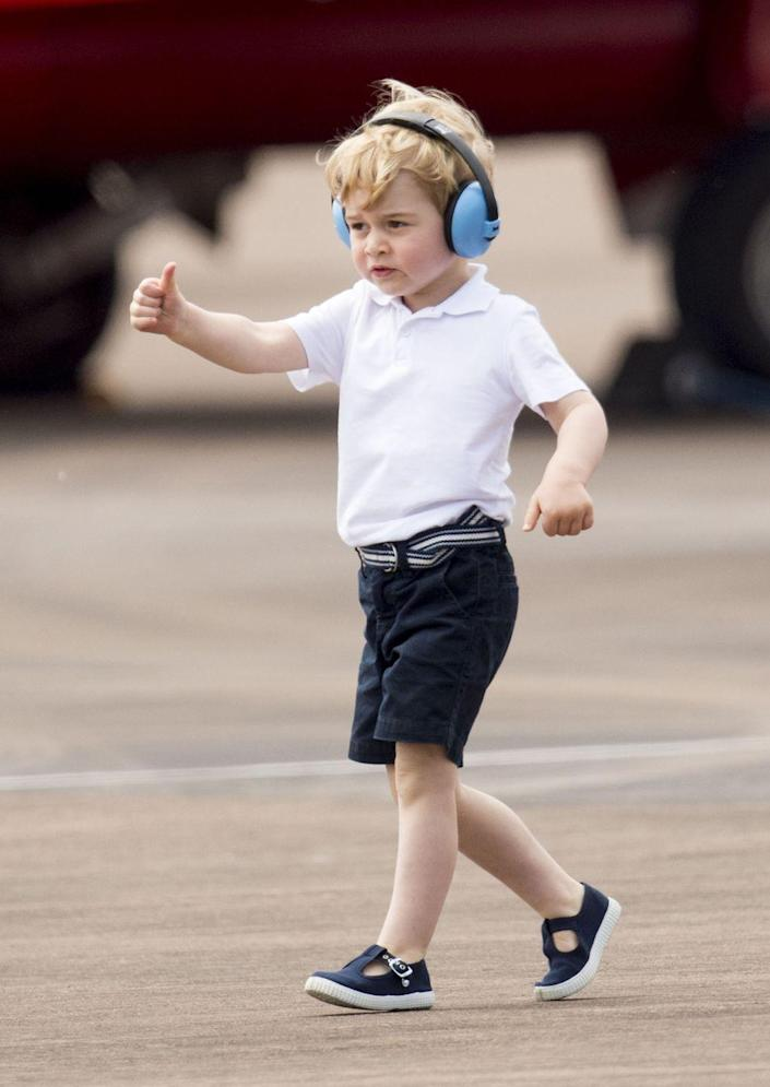 """<p>A big thumbs up for <a href=""""https://www.townandcountrymag.com/society/tradition/a6896/prince-george-pictures-air-show-kate-middleton/"""" rel=""""nofollow noopener"""" target=""""_blank"""" data-ylk=""""slk:Prince George's first official royal engagement"""" class=""""link rapid-noclick-resp"""">Prince George's first official royal engagement</a> at the Royal International Air Tattoo at RAF Fairford in Gloucestershire.</p>"""