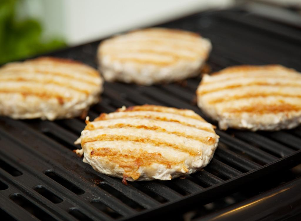 """<strong>Mistake</strong>: """"Ever had burger patties that were rounded and not flat? These types of burgers are awkward to eat! People tend to forget that flattening your patty before cooking is essential to making that perfect burger form,"""" Derek Wolf, fire cooking enthusiast and owner of <a rel=""""nofollow"""" href=""""https://www.overthefirecooking.com/"""">Over the Fire Cooking</a>, reminds us.  <strong>Solution</strong>: """"Flatten the patties by pressing them flat using a burger press. If you don't have a burger press, then try pressing together two plates or two cutting boards to get that flat burger form. Fun tip: If you are looking to double stack burgers, make sure to have thin patties or else you will have a very tall burger!"""""""