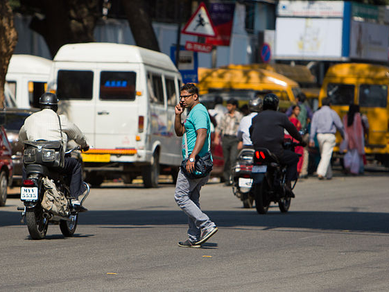 Bangalore guy on cell phone street