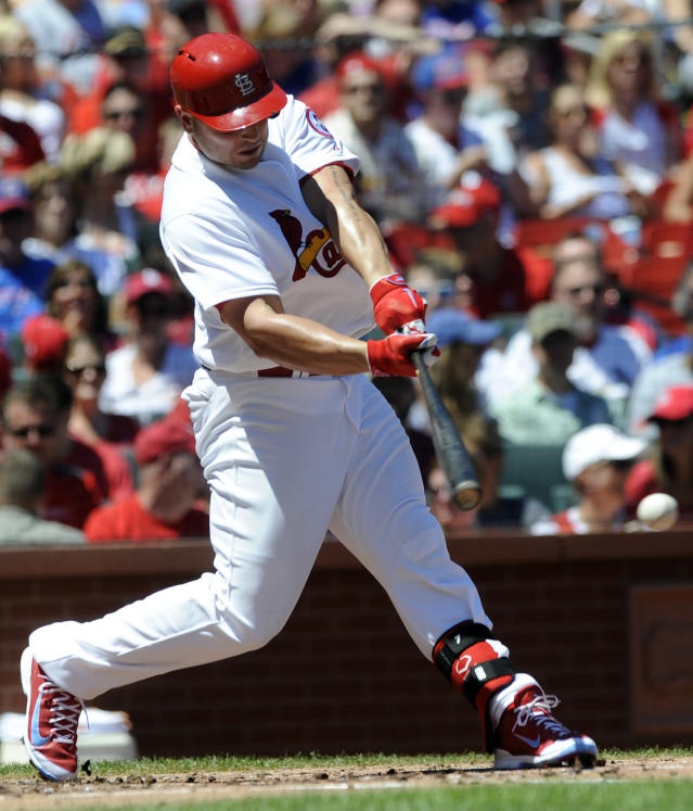 St. Louis Cardinals' Matt Holliday connects on an RBI-single against the Chicago Cubs in the first inning in a baseball game on Sunday, Aug. 11, 2013, at Busch Stadium in St. Louis. (AP Photo/Bill Boyce)