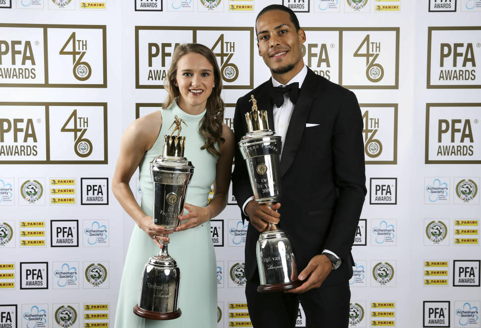 Liverpool's Virgil van Dijk poses with his PFA Player of the Year award with PFA Female Player of the Year Arsenal's Vivianne Miedema during the 2019 PFA Awards at the Grosvenor House Hotel, London, Sunday April 28, 2019. Virgil van Dijk has been voted English soccer's player of the year in recognition of his commanding performances in Liverpool's defense as it bids to win the top-flight title for the first time since 1990. (Barrington Coombs/PA via AP)