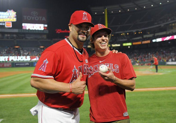 Los Angeles Angels' Albert Pujols, right, poses with Scotty Steffel after Steffel gave caught and gave him his 600th home run ball following a baseball game against the Minnesota Twins, Saturday, June 3, 2017, in Anaheim, Calif. Pujols hit his 600th career home run in the fourth inning. (AP Photo/Mark J. Terrill)