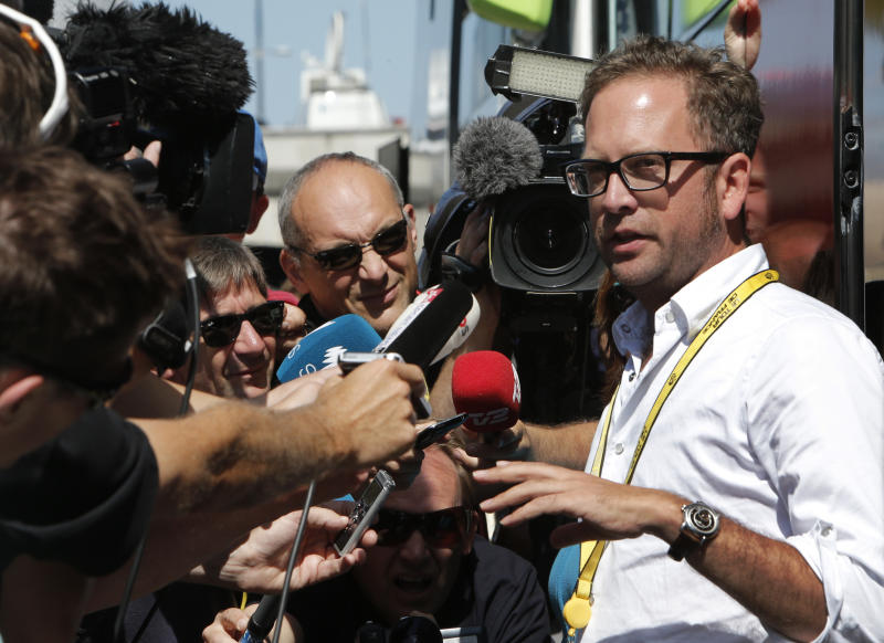 "Jonathan Vaughters, a director of Garmin-Sharp, right, denied that any of the cycling team's riders have been banned for six months by the U.S. Anti-Doping Agency as part of its doping probe into seven-time Tour de France winner Lance Armstrong during an improvised press conference outside the team bus prior to the start of the fifth stage of the Tour de France cycling race over 196.5 kilometers (122 miles) with start in Rouen and finish in Saint-Quentin, France, Thursday July 5, 2012. Vaughters said Thursday that a Dutch media report about six-month bans is ""completely untrue."" Dutch newspaper De Telegraaf reported Wednesday that Vaughters and four other former Armstrong teammates have been given six-month bans to begin in late September. De Telegraaf cites unnamed ""well-informed sources"" in its report that Vaughters, George Hincapie, Levi Leipheimer, David Zabriskie and Christian Vande Velde received the bans after admitting to doping and agreeing to give evidence against Armstrong. (AP Photo/Laurent Rebours)"