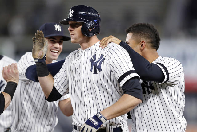 New York Yankees' Tyler Wade, left and Gleyber Torres celebrate with DJ LeMahieu, center, who hit a walk-off single in the Yankees' 5-4 victory over the Seattle Mariners in a baseball game Tuesday, May 7, 2019, in New York. (AP Photo/Kathy Willens)