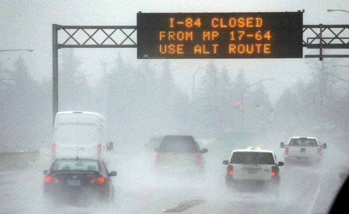 A traffic sign alerts drivers on Interstate 84 in Troutdale, Ore., of road closures, Wednesday, Jan. 18, 2017. An ice storm shut down parts of major highways and interstates Wednesday in Oregon and Washington state and paralyzed the hardest hit towns along the Columbia River Gorge with up to 2 inches of ice coating the ground in some places.(AP Photo/Don Ryan)