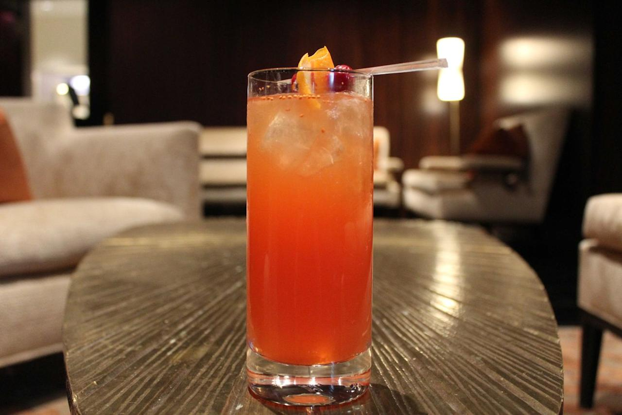"""<p><strong>Recipe:<br></strong>1.5 oz sparkling water<br>2 oz cranberry juice<br>4 dashes Peychaud's Bitters<br>2.5 oz apple cider<br>10 cranberries (plus additional for garnish)<br>Orange wedge</p><p><strong>Directions:<br></strong>Muddle cranberries and orange wedge in cranberry juice, and then pour in the rest of the ingredients and stir with a spoon. Garnish with cranberries and orange peel and serve on ice.</p><p><em>From the </em><em>Waldorf Astoria Chicago</em></p><p><strong>More</strong>: <a href=""""https://www.townandcountrymag.com/leisure/drinks/g1022/holiday-cocktails/"""" target=""""_blank"""">25+ Different Ways to Make a Festive Holiday Cocktail</a><br></p>"""